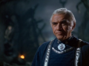 Commander Adama.  On the same night, he loses his youngest son and his wife to a battle that changes the face of the war, yet is not allowed to grieve openly.  Such is the burden of leadership.