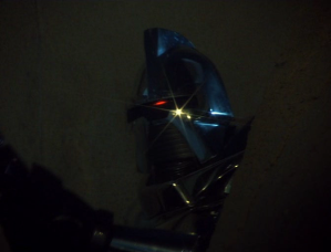 "A Cylon conveniently lands on the planet to cause a poignant death scene in the final act of ""Lost Planet of the Gods."""