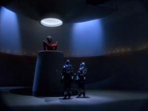 "The Cylon ""Imperious Leader"" on the throne.  How does he get down from there?"
