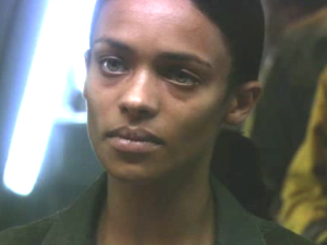 Dualla.  Like most Women of Color in Sci-Fi, she is background clutter, often used to supply cheap moments of angst.